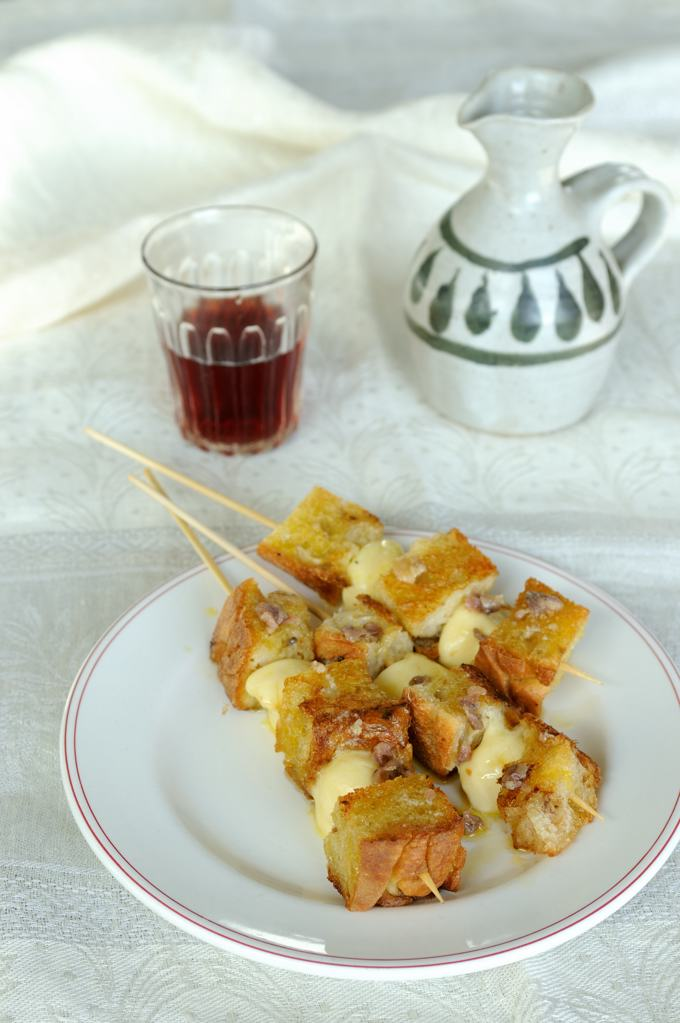 Cheese, toast & anchovy skewers
