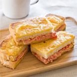 Smoked ham, semi-dried tomato & aioli toastie with parmesan