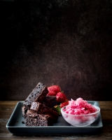 Sticky Chocolate Brownie with blood orange sorbet and strawberries