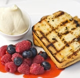 Chargrilled lemon loaf with berries & strawberry sauce